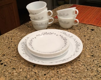 5 Pyrex Coffee Cups/ Mugs, 6 Corelle bread and butter plates and 1 dinner plate..Grey flower ribbon pattern!