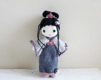 Geisha doll, Japanese Geisha in a gray kimono