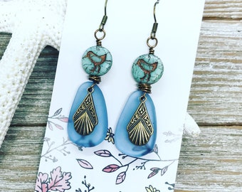 Mint green biddie beads wire wrapped with blue faux sea glass and vintage bronze charm.