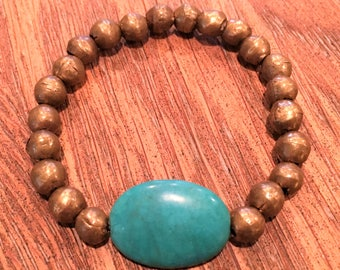Bracelet made of antique balinese beads with a turquoise bead accent