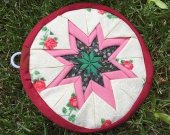 Pink rose and green quilted star potholder/trivet