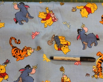Winnie the Pooh , Piglet, Tigger and Eeyore on bright blue.  100% cotton fabric by Disney for Springs Ind.
