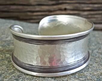 Wide hammered silver bracelet