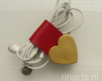 Earbuds / earphone / cable organizer/ cord holder Heart Arrow in red and gold painted veg tanned bridle leather. Gift for women.