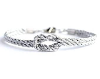 Metallic silver forever knot nautical rope bracelet with silver heart charm