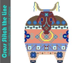 Folk bull cross stitch pattern. Modern cross stitch based on the Brazilian legend and festival of Bumba meu Boi. Contemporary tribal design.