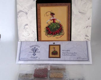 Mirabilia Cross Stitch Chart and embellishment pack by Nora Corbett Mirabilia Designs MD-148 Miss Christmas Eve