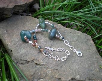 In Her Garden beaded bracelet, fancy jasper, sterling silver, feather charm