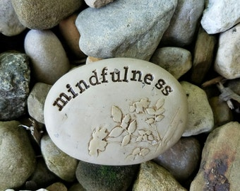 Mindfulness meditation clay stone, textured zen pebble