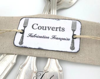 Covered antique metal French plate