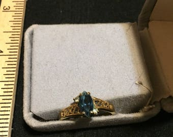 Size 9 vintage 14kt gold electroplated ring with a big blue stone in the middle with two little white ones on the side