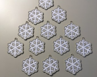 One dozen silver trimmed mini snowflakes