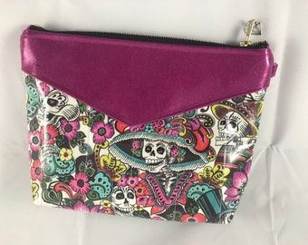 Vegan clutch/crossbody purse in a fuschia sparkle vinyl and day of the dead fabric