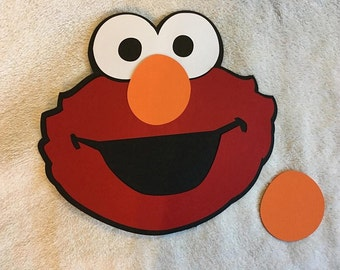 Pin the Nose on Elmo with 10 extra noses. Great for birthday parties!! Free Shipping