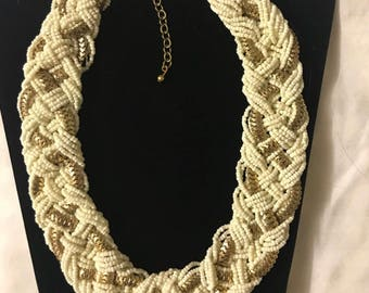 White gold beaded braided necklace . White and gold statement necklace with matching earrings. White and gold beaded necklace.
