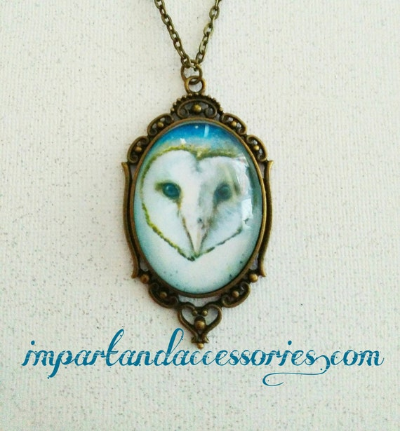 GALAXY OWL-  30x40mm glass cabochon cameo necklace with brown and white owl on a blue starry background set in bronze filigree setting.