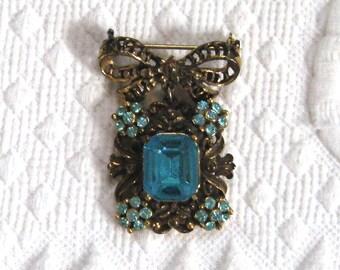 Filigree Bow Brooch . pendant brooch .  Turquoise Czech Glass Brooch . Dangling Brooch