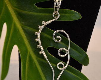 solid sterling silver wire leaf pendant.  handmade. with or without chain.