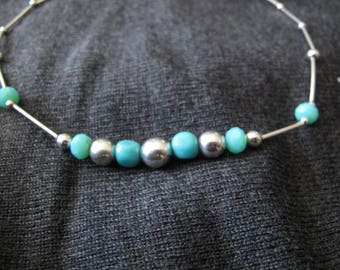 Beaded stone necklace with silver tubes
