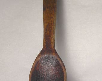 An Antique Hand Carved Wooden Spoon A8