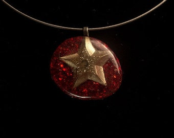 Gold Star Pendant on a Silver Wire Necklace