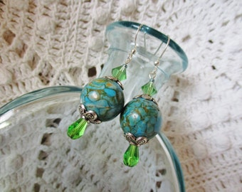 Turquoise dangle earrings with silver and green glass