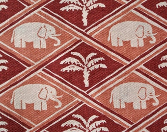Vintage 1940s unused printed cotton fabric with larger palm/ elephant harlequin motive in vinered/ light rust colors