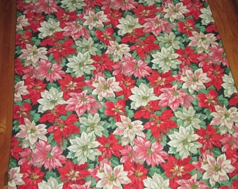 "1980's poinsettia pattern linen tablecloth measures 84"" x 60"""