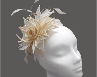 Stunning champagne & white sinamay fascinator with rose effect centre, pale gold diamanté and feather on an aliceband headband. Weddings.