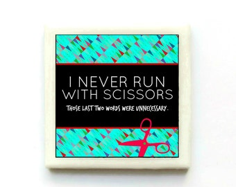 Never runs with scissors.  Those last two words were unnecessary. - Handmade Tile Magnet