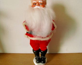 Mid Century Santa doll with stand. Plastic face, poseable arms, the softest beard ever. Originally held Mauro-Pennisi Inc candy.