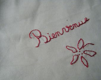 hand made fabric for patchwork with a beige background and Red/Burgundy embroidery