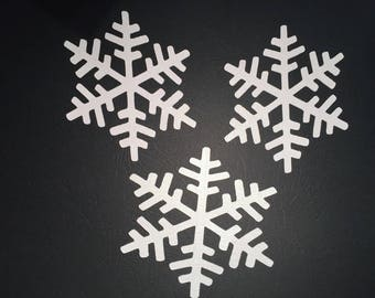 Set of three large embellishments in the shape of pearly white snowflake