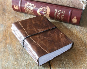 """Leather Journal . Jack Kerouac: """"One day I will find the right words, and they will be simple."""" dark brown with elastic closure (320 pgs)"""