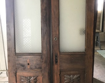 Antique double doors with etched glass and matching etched transom.
