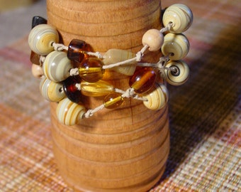 knotted beaded bracelet in ambers, tans, yellows