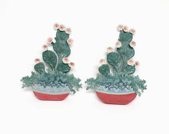 Pair of Dimensional Cactus Wall Decorations Made of Painted Metal and Wood in Hues of Green, Blue, & Pink