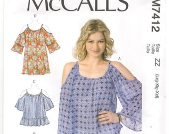 McCall's 7412 Size L, XL, XXL, 16, 18, 20, 22, 24, 26 Plus size top / tunic sewing pattern for women. Cold shoulder, long / short sleeve