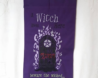 A Witch lives here - decorative banner