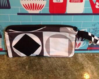 Mod retro wristlet.  Black and white geometric shapes.  Zippered bag. Handmade wristlet.