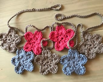 Garland of flowers crocheted, pink, pale blue and gray
