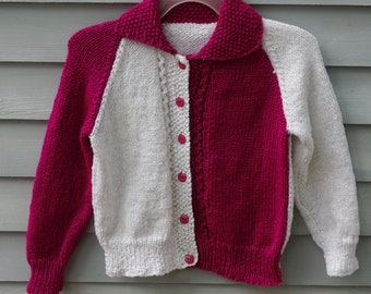 Girl, size 6/8, two color cardigan sweater, white and fuchsia.