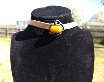 Tan leather choker with yellow stone