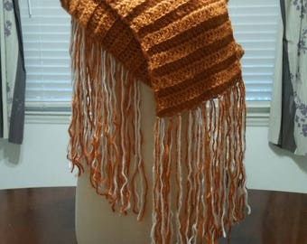 Apricot scarf with fringe.