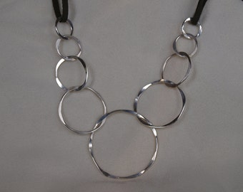 hand hammered silver chain necklace, leather cording