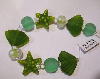 Matte Shades of Green Lampwork Glass Beads of the Sea Set of 10 Beads Starfish Shells