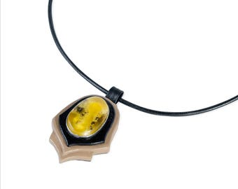 Handmade leather pendant with Baltic amber