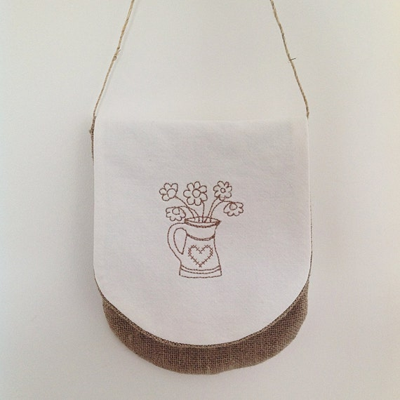 Hand-sewn and embroidered linen pouch for hanging up
