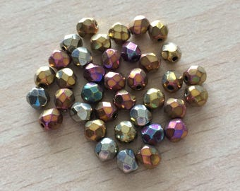 Bag of beads with Multi faceted iridescent gold