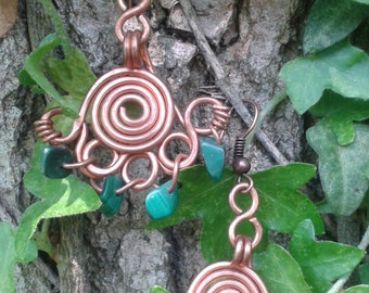Handmade copper spiral earrings with stones (malachite) in ancient Celtic style